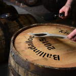 Stencilling the casks at Ballindalloch Distillery