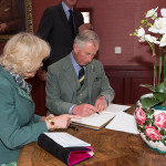 Duke and Duchess of Rothesay sign the visitors book at Ballindalloch Distillery